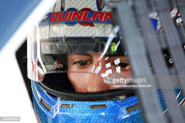 Grant Quinlan driver of the International Tool Mold Toyota looks on prior to the NASCAR KN Pro Series East Stafford 150 at Stafford Motor Speedway on...