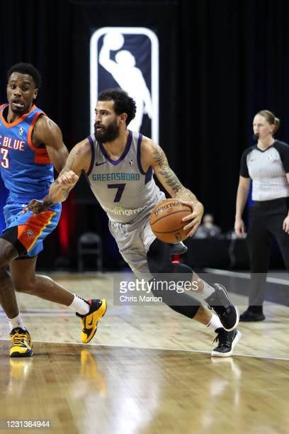 Grant Riller of the Greensboro Swarm handles the ball against the Oklahoma City Blue on February 24, 2021 at HP Field House in Orlando, Florida. NOTE...