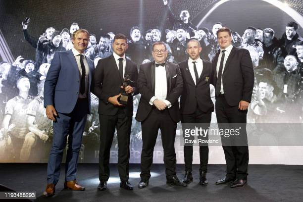 Grant Robertson Minister of Sport presents The adidas National Team of the Year are to the Crusaders during the New Zealand Rugby Awards at the Sky...