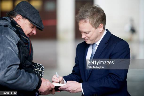 Grant Shapps Secretary of State for Transport signs an autograph as he leaves BBC Broadcasting house after attending the Andrew Marr Sunday Morning...