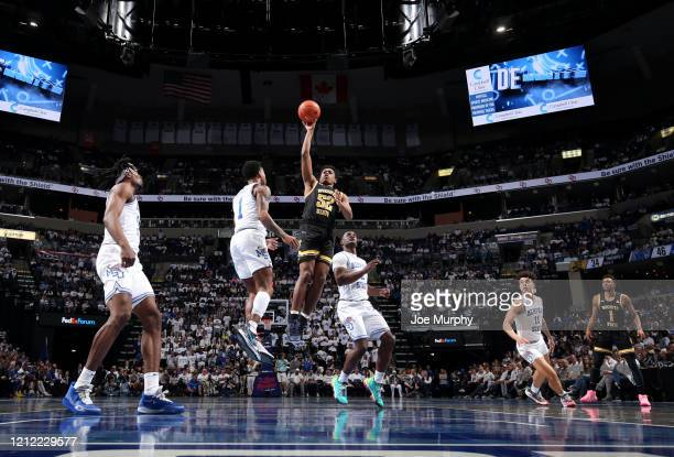 Grant Sheffield of the Wichita State Shockers drives to the basket against Tyler Harris of the Memphis Tigers during a game on March 5 2020 at...