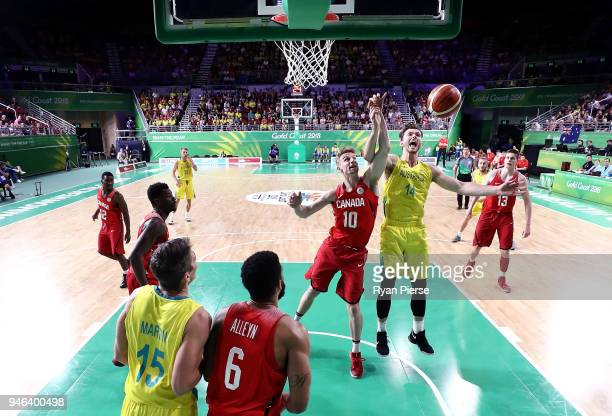 Grant Shephard of Canada and Angus Brant of Australia contest the ball during the Men's Gold Medal Basketball Game between Australia and Canada on...