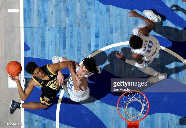 Grant Sherfield of the Wichita State Shockers drives to the basket against Isaiah Maurice of the Memphis Tigers during a game on March 5 2020 at...