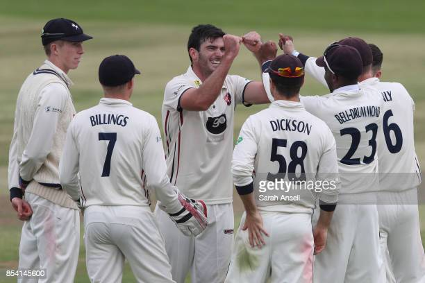 Grant Stewart of Kent celebrates his first 1st class wicket on his debut with teammates after dismissing Craig Meschede of Glamorgan during day two...