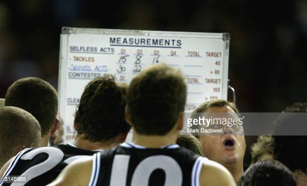 Grant Thomas, coach of the Saints addresses his players during the round one AFL match between the St Kilda Saints and the Geelong Cats at the...