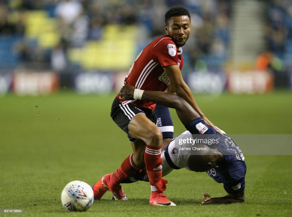 Grant Ward of Ipswich and Tom Elliott of Millwall battle for possession during the Sky Bet Championship match between Millwall and Ipswich Town at The Den on August 15, 2017 in London, England.