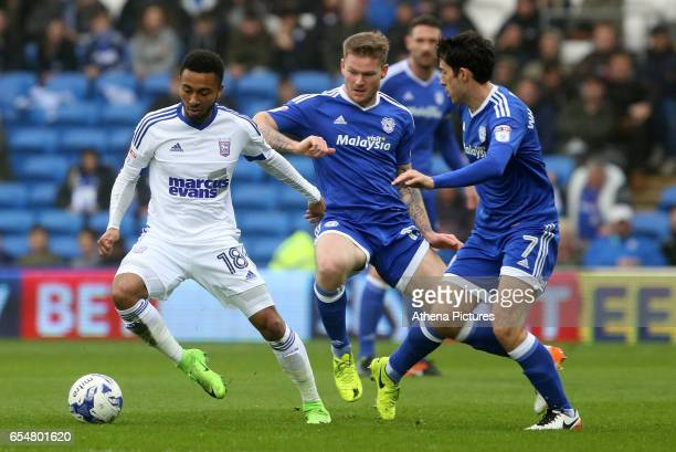 Grant Ward of Ipswich Town is challenged by Aron Gunnarsson and Peter Whittingham of Cardiff City during the Sky Bet Championship match between...