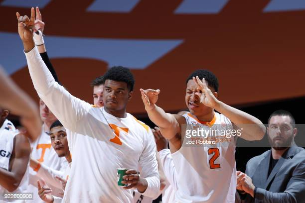 Grant Williams and Derrick Walker of the Tennessee Volunteers react after a threepoint basket against the Florida Gators in the second half of a game...