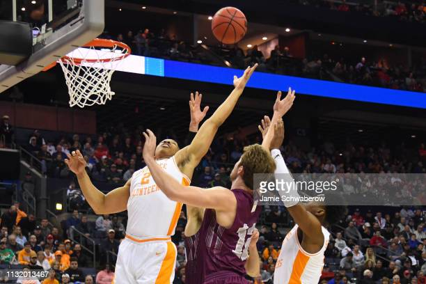 Grant Williams and Lamonte Turner of the Tennessee Volunteers try to grab a rebound from Dana Batt of the Colgate Raiders in the first round of the...