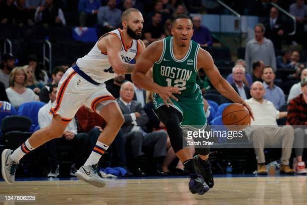 Grant Williams of the Boston Celtics dribbles as Evan Fournier of the New York Knicks defends during the second half at Madison Square Garden on...