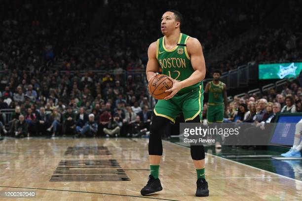 Grant Williams of the Boston Celtics handles the ball during a game against the Milwaukee Bucks at Fiserv Forum on January 16 2020 in Milwaukee...