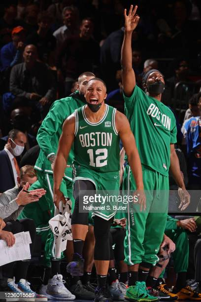 Grant Williams of the Boston Celtics yells and celebrates on the bench against the New York Knicks on October 20, 2021 at Madison Square Garden in...