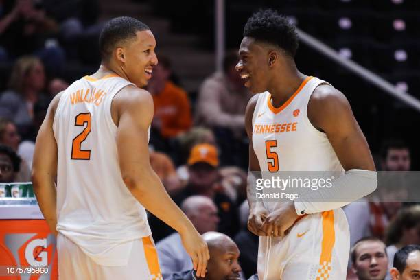 Grant Williams of the Tennessee Volunteers and Admiral Schofield of the Tennessee Volunteers celebrate on the bench during the second half of the...