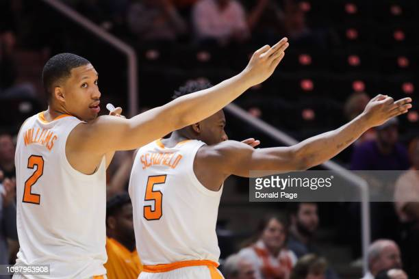 Grant Williams of the Tennessee Volunteers and Admiral Schofield of the Tennessee Volunteers celebrate on the bench during the second half of their...