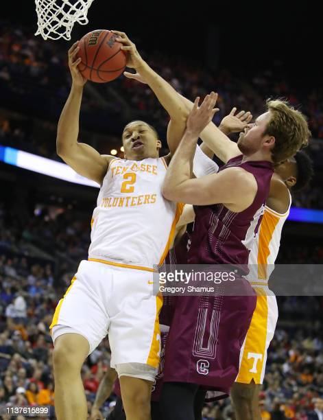 Grant Williams of the Tennessee Volunteers battles for the ball with Dana Batt of the Colgate Raiders during the first half in the first round of the...