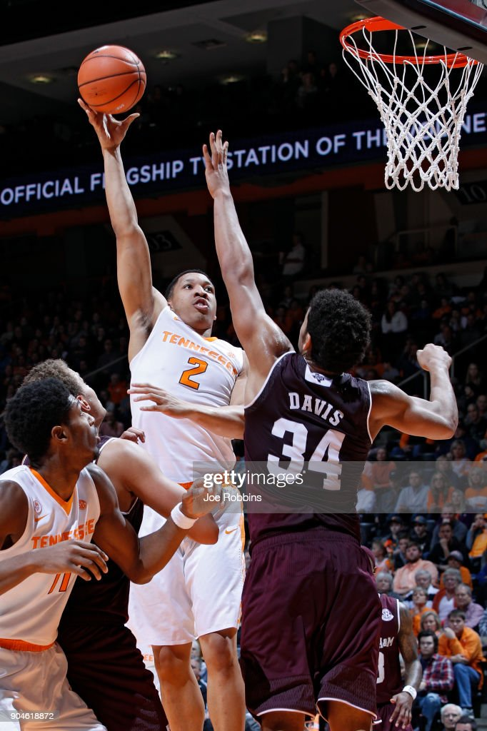 Grant Williams #2 of the Tennessee Volunteers goes to the basket against Tyler Davis #34 of the Texas A&M Aggies in the first half of a game at Thompson-Boling Arena on January 13, 2018 in Knoxville, Tennessee.