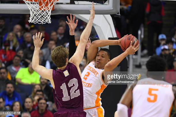 Grant Williams of the Tennessee Volunteers grabs a rebound away from Dana Batt of the Colgate Raiders in the first round of the 2019 NCAA Photos via...