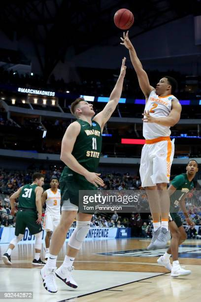 Grant Williams of the Tennessee Volunteers shoots over Loudon Love of the Wright State Raiders in the first half in the first round of the 2018 NCAA...