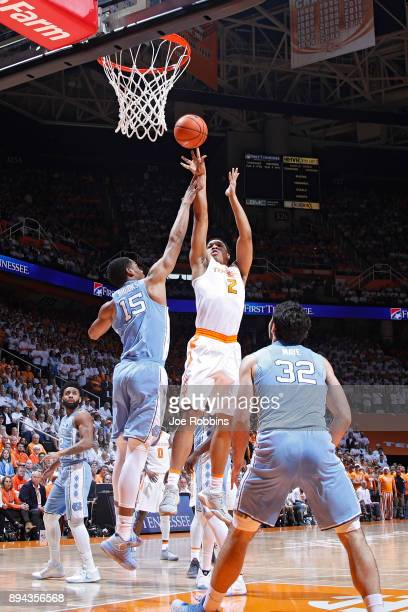 Grant Williams of the Tennessee Volunteers shoots the ball against Garrison Brooks of the North Carolina Tar Heels in the first half of a game at...