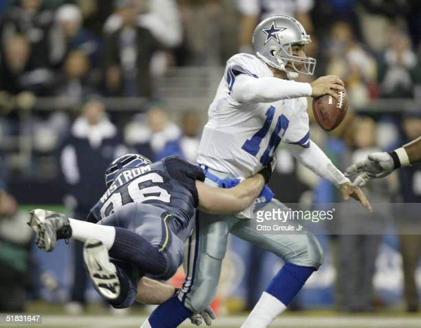 Grant Wistrom of the Seattle Seahawks sacks quarterback Vinny Testaverde of the Dallas Cowboys to force the Cowboys to 3rd and 20 in the 4th quarter...