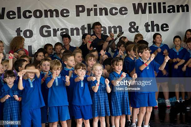 Grantham primary school students entertain HRH Prince William at Grantham on March 20 2011 in Brisbane Australia His Royal Highness is in Queensland...