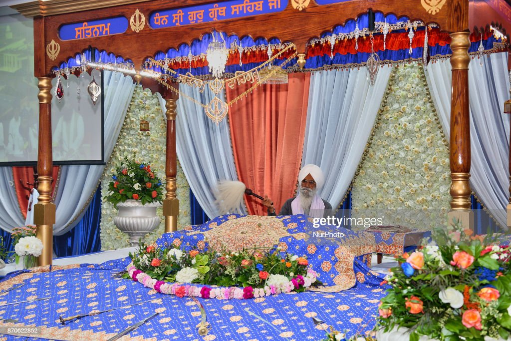 A Granthi reveres the Sri Guru Granth Sahib at a Gurdwara during Gurpurab on November 04 2017 in Mississauga Ontario Canada Guru Nanak Gurpurab also..