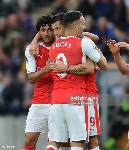 Granti Xhaka celebrates scoring the 4th Arsenal goal with Mohamed ELneny and Lucas Perez during the Premier League match between Hull City and...