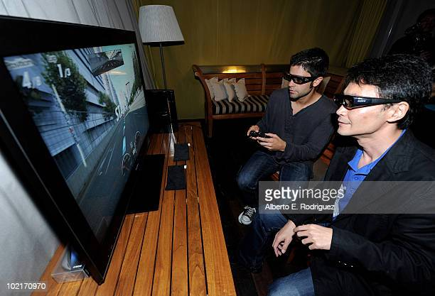 GranTurismo producer Kazunori Yamauch and actor Adrian Grenier play Gran Turismo on Sony 3D as MercedesBenz celebrates PlayStation 3 Gran Turismo 5...