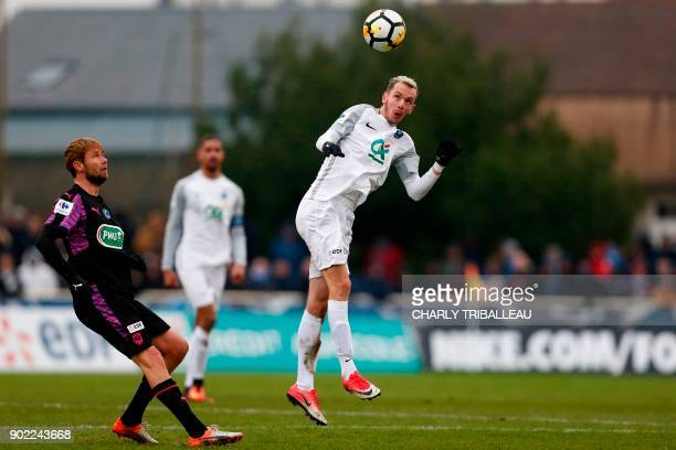 Granville's Jonathan Beaulieu fights for the ball with Bordeaux's Czech midfielder Jaroslav Plasil during the French Cup football match between...