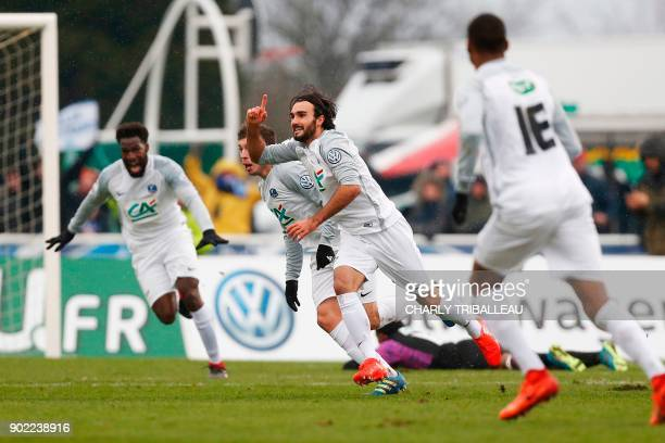 Granville's Sullivan Martinet celebrates with teammates after scoring a goal during the French Cup football match between Granville and Bordeaux at...