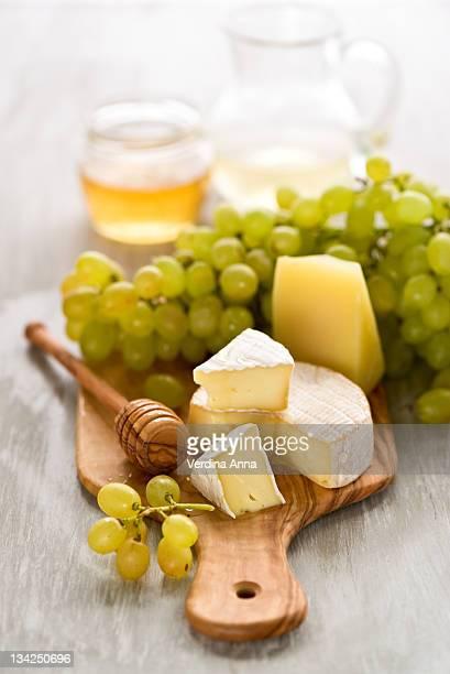 grape, honey and cheese - anna verdina stock photos and pictures