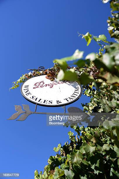 Grape vines grow on a sign outside the cellar door of Treasury Wine Estates Ltd's Penfold's winery in the Barossa Valley Australia on Monday March 4...