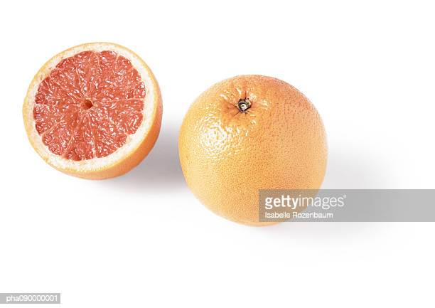 A grapefruit and a half, white background