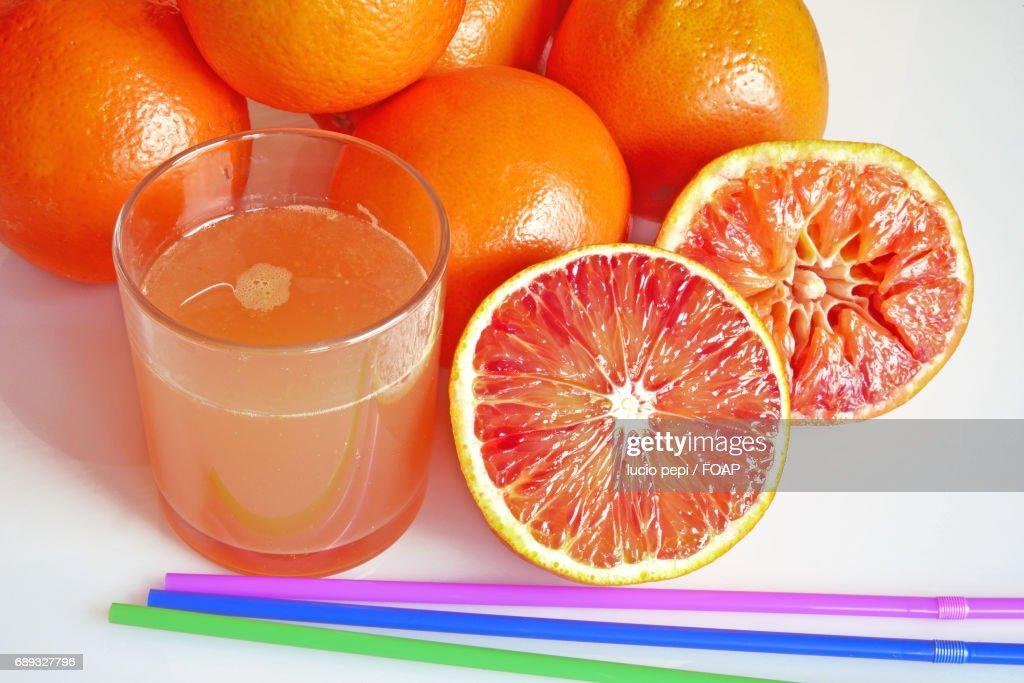 Grapefruit juice and slice of grapefruit : Stock Photo