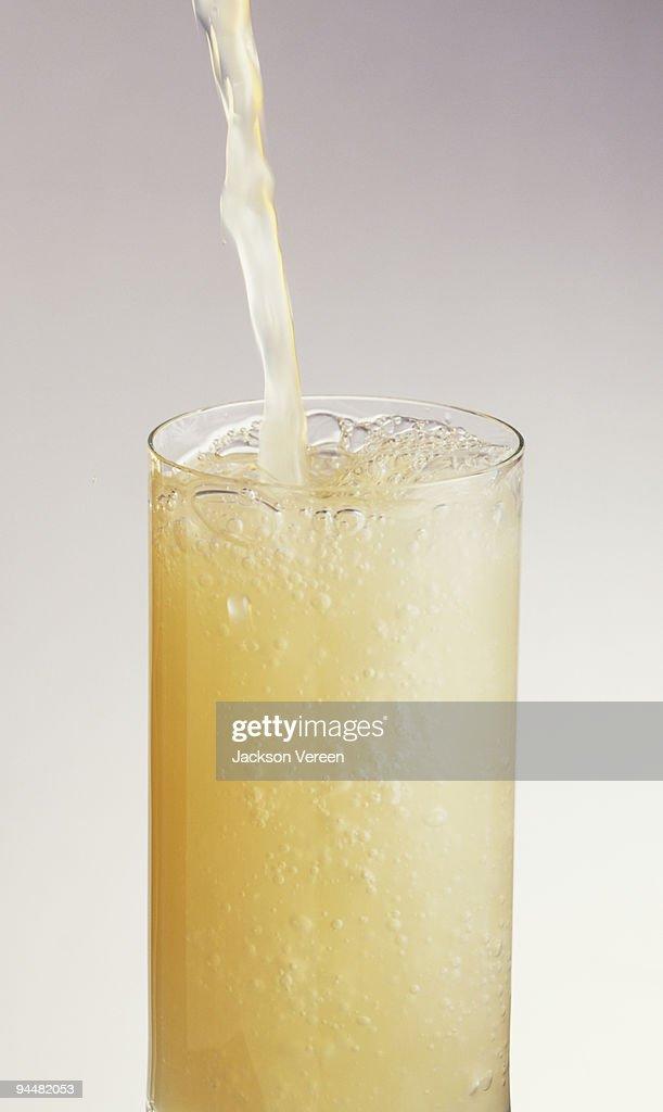 Grapefruit juice pour : Stock Photo