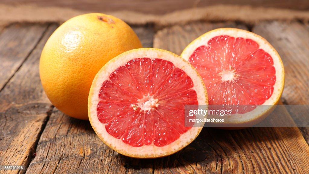 grapefruit on wood background : Stock Photo