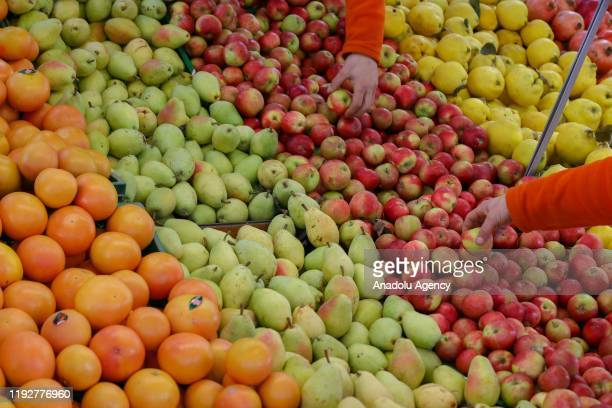 Grapefruits , pears apples and quinces are seen at a stand in Izmir, Turkey on January 9, 2020.