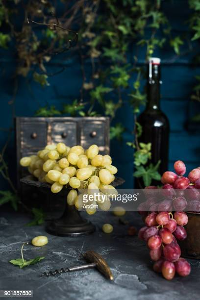 Grapes and bottle of wine.
