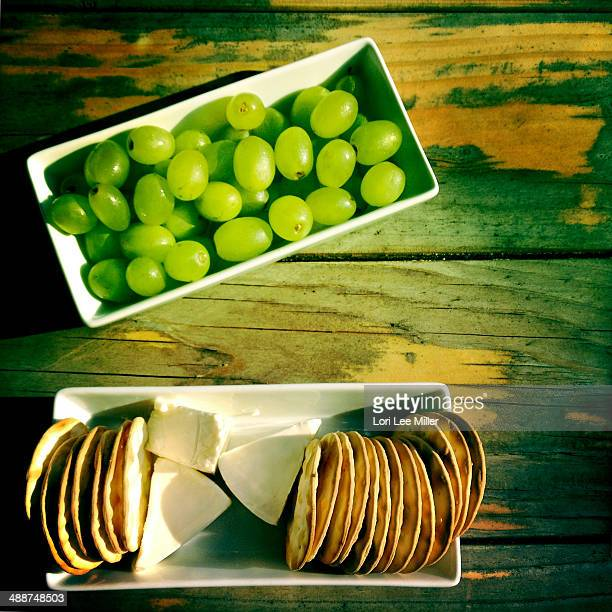 grapes and brie cheese - lori lee stock pictures, royalty-free photos & images