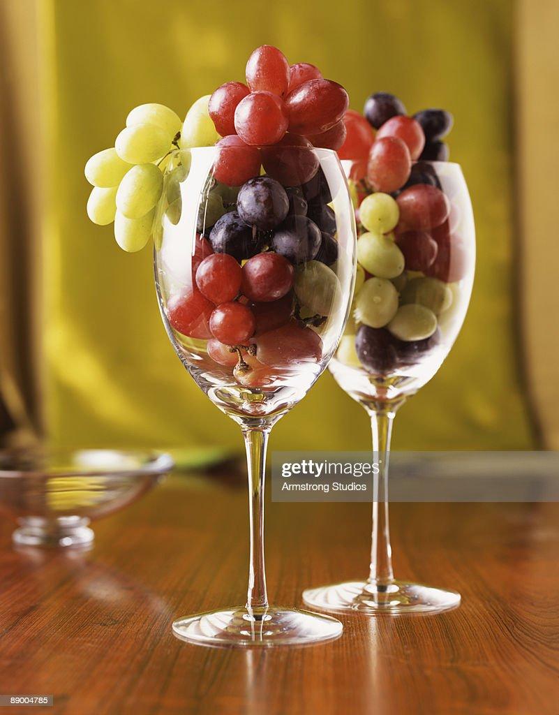 Grapes in wine glasses : Stock Photo