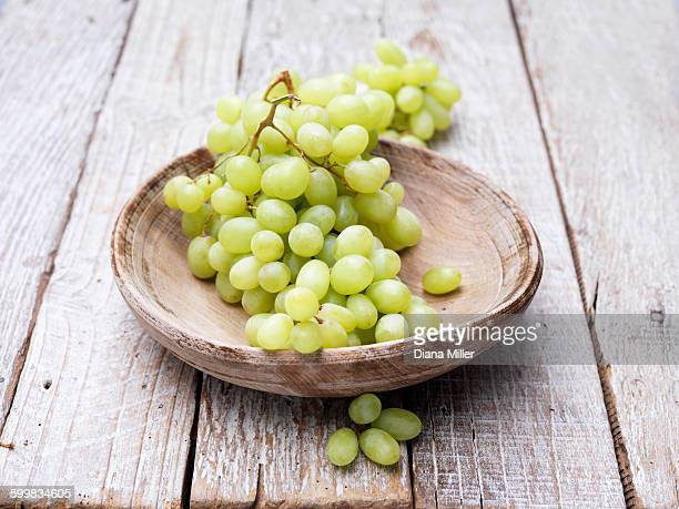 grapes in wooden bowl - white grape stock photos and pictures