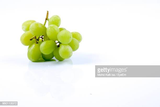 grapes on white background - grape stock pictures, royalty-free photos & images