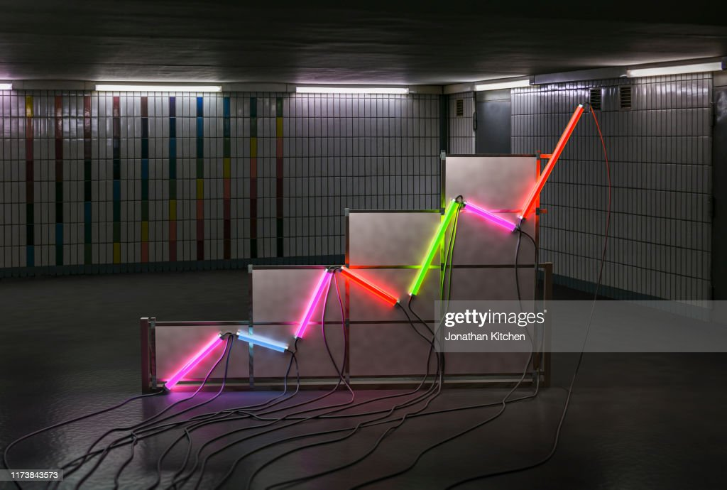 A graph made of neon tubes in a room : Stock-Foto