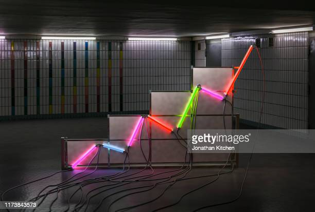 a graph made of neon tubes in a room - calculating stock pictures, royalty-free photos & images