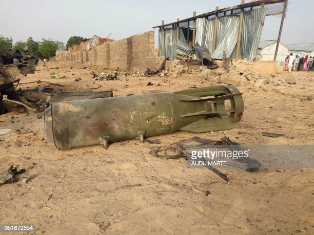 Graphic content / A bomb from air strike by the Nigerian airforce lies on the ground after cross fire between the military and Boko Haram Islamists...