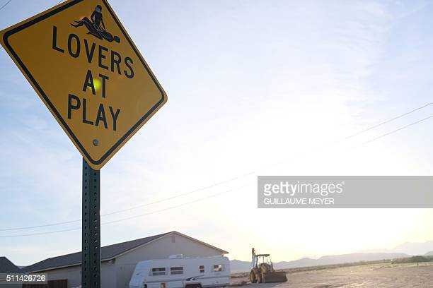Graphic content / A caution sign at the Love Ranch legal brothel in Crystal, Nevada, on February 19, 2016. / AFP / Guillaume MEYER