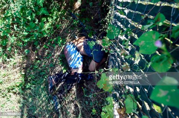 Graphic content / A corpse lies in the bush after heavily armed gunmen waged an allout battle against Mexican security forces in Culiacan Sinaloa...