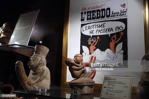 Graphic content / A cover of French satirical magazine HaraiKiri drawn by French cartoonist Georges Wolinski is pictured among other erotic art...