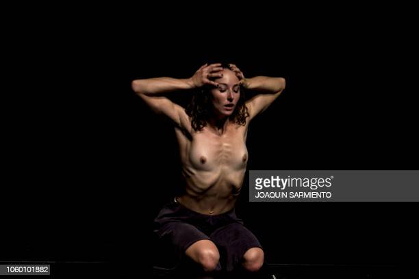 Graphic content / A dancer from the New Yorkbased dance company ZviDance performs during the Medellin international Dance Festival at the...