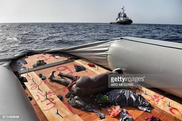 Graphic content / A dead body lies on a boat after some migrants were rescued by members of Proactiva Open Arms NGO in the Mediterranean Sea some 12...